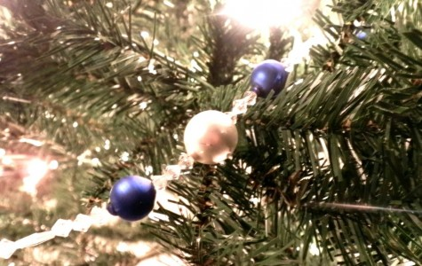 Decorating  a Christmas tree is a holiday tradition many families have.