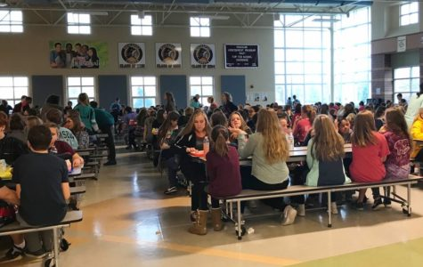Cherokee's cafeteria is always packed in tight at lunchtime. This is during the 7th grade lunch time.