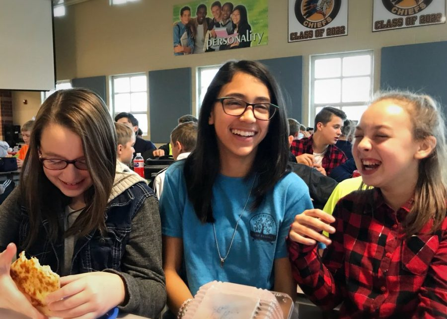 Emily, Delicia, and Gabby are always laughing away at lunch. They are a great example of middle school friends.